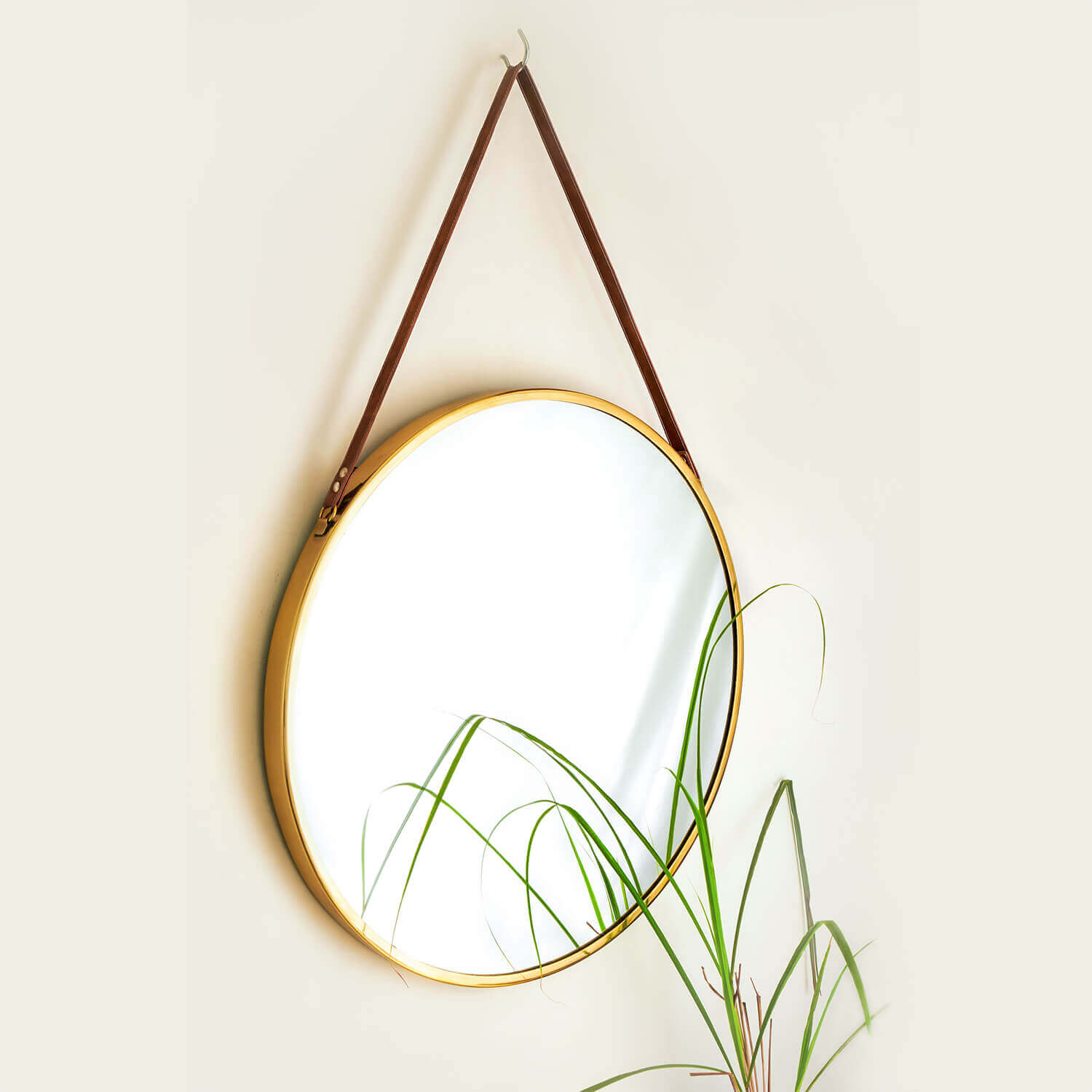 round gold brass mirror